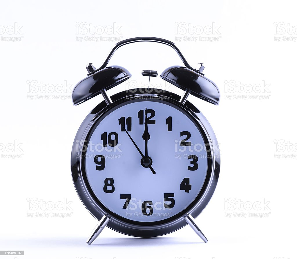 Alarm Clock  with twelve o'clock royalty-free stock photo