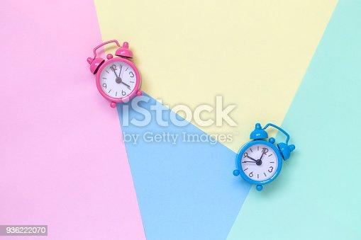 istock Alarm clocks on multicolored pastel background minimalistic concept. 936222070