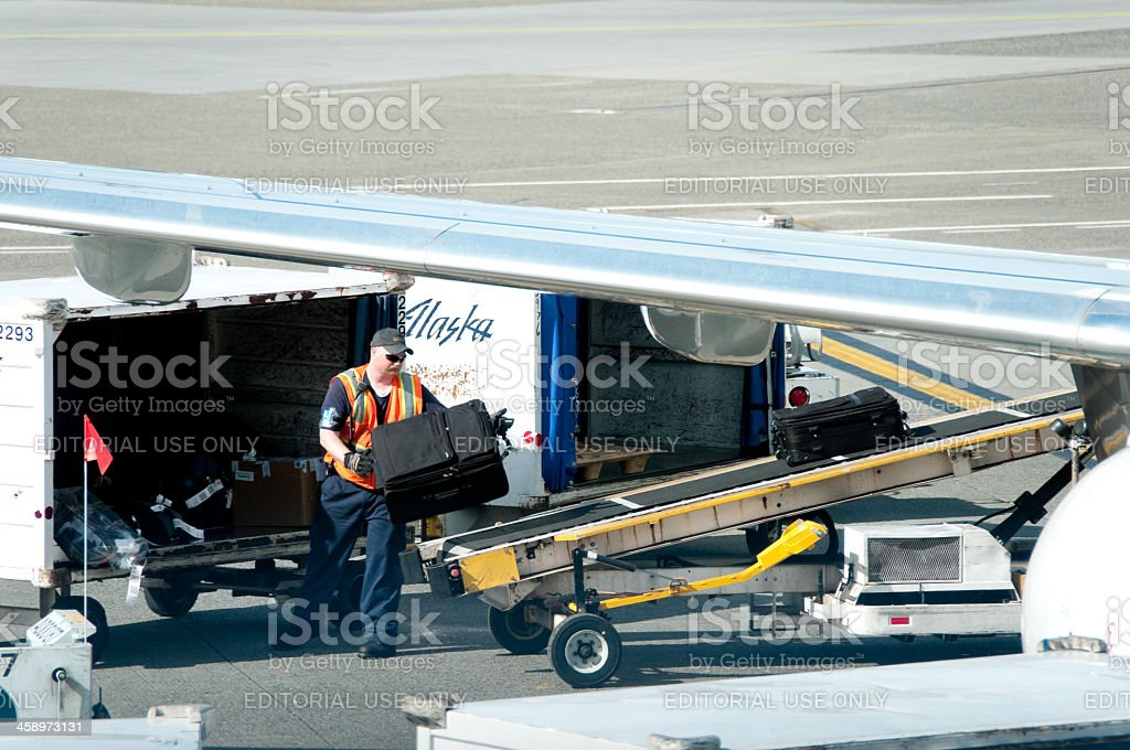 Alaska Airlines Baggage Handler Stock Photo More Pictures Of Air