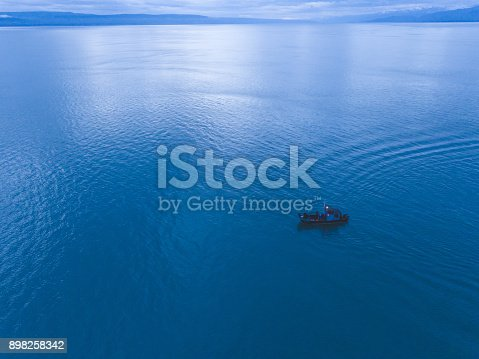 istock Alaska fishing boat alone on the water 898258342