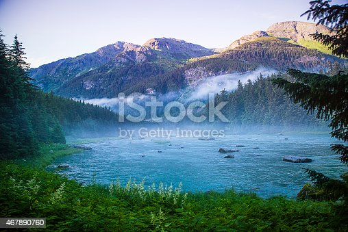 Sunset image of Chilcoot River in Haines, Alaska. Photo was taken about an hour before sunset in July after a 3 day long rain. The fog finally lifted and the sun came out to reveal this beautiful mountain view.