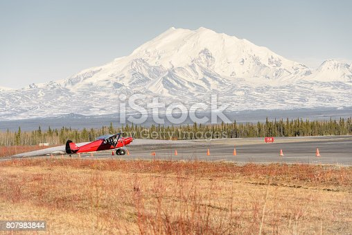 istock Alaska Remote Airport in Spring With Bush Plane and Mountain 807983844
