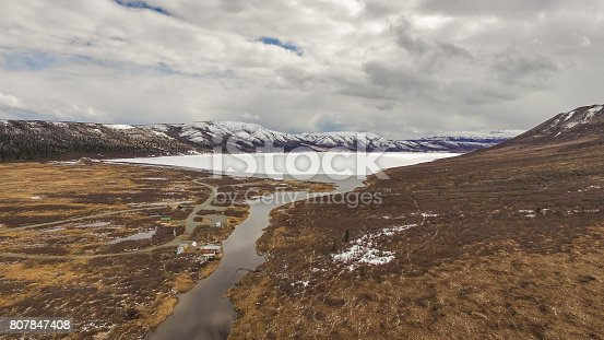 istock Alaska Remote Lake With Campers in Early Spring 807847408