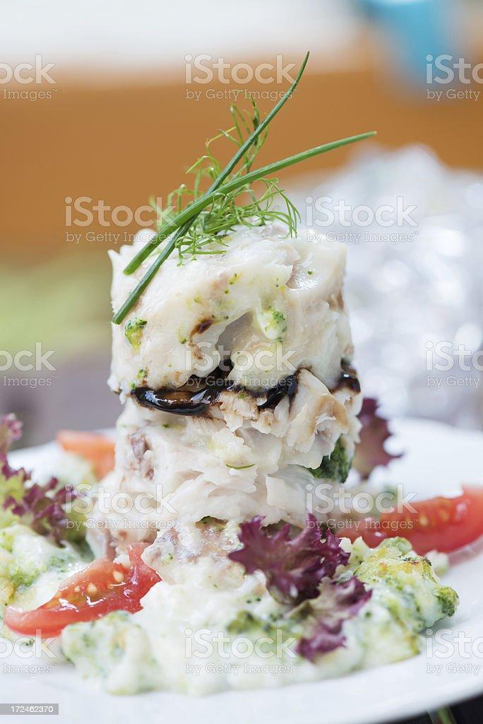 Alaska sea salmon filet on broccoli cream bed royalty-free stock photo
