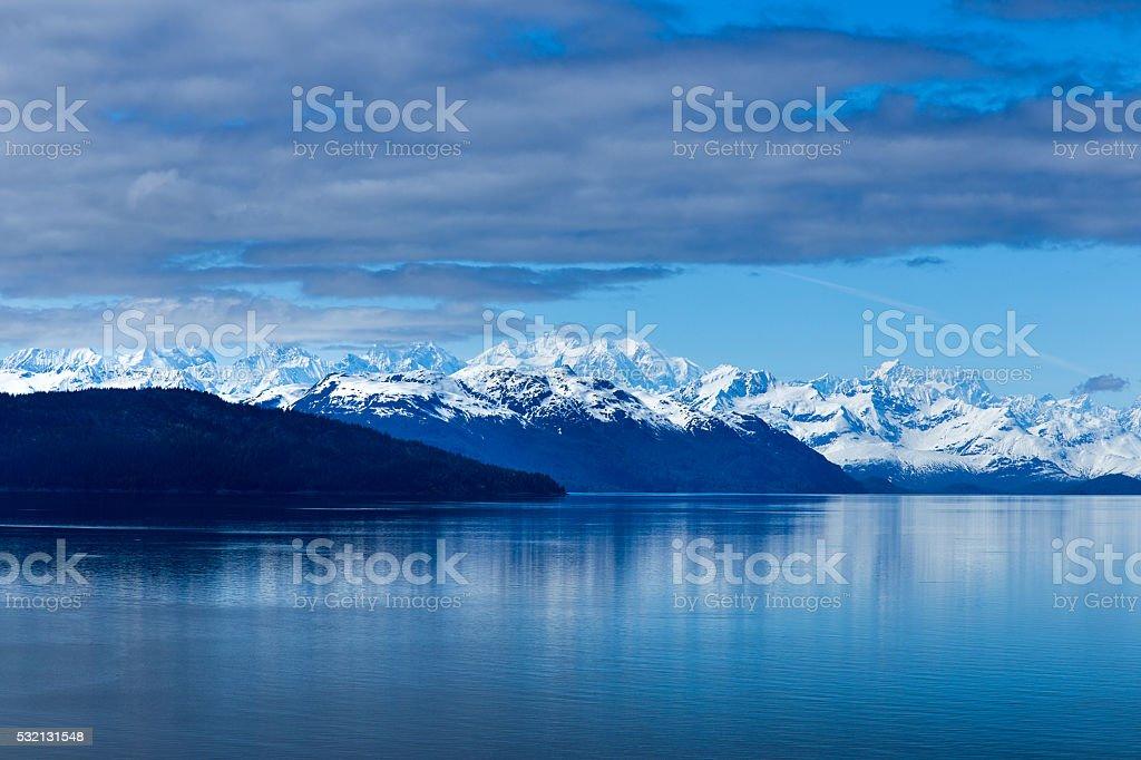 Alaska Snow Mountain and ocean stock photo