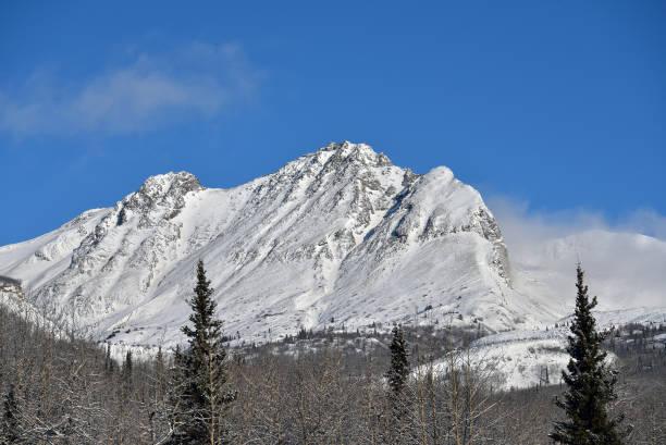 Alaska snowy mountain landscape stock photo