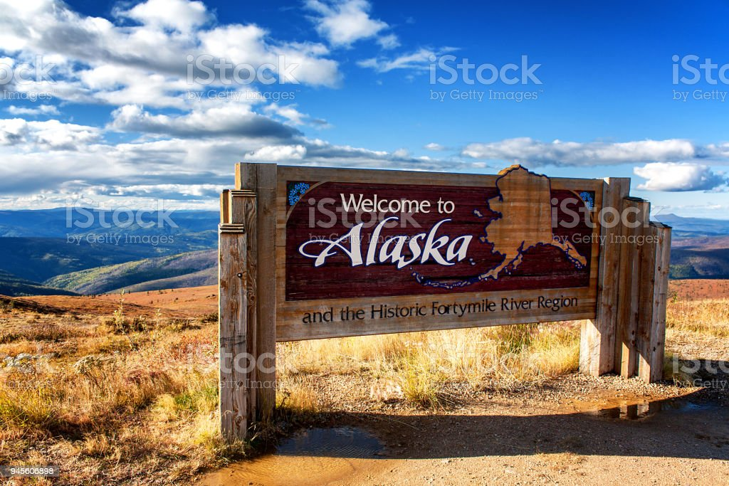 Alaska, USA: Welcome to Alaska sign at Canadian border on Top of the World Highway stock photo
