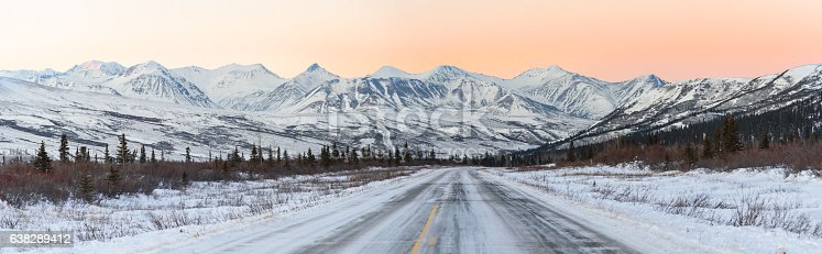 1066508460 istock photo Alaska Winter Highway at Sunset With Mountains in Background 638289412