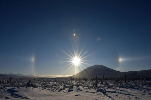 Alaska winter sun halo stock photo