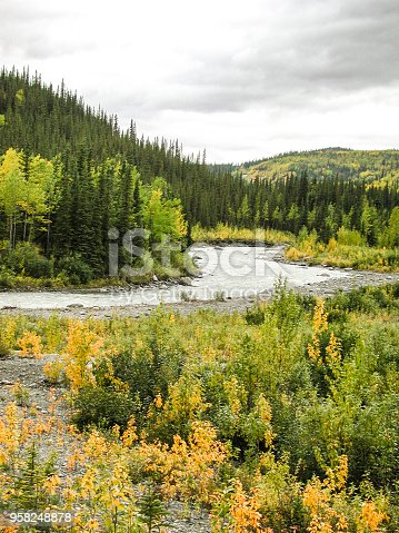 Autumn Alaskan landscape view of river, mountains and clouds.  Taken in Alaska, USA