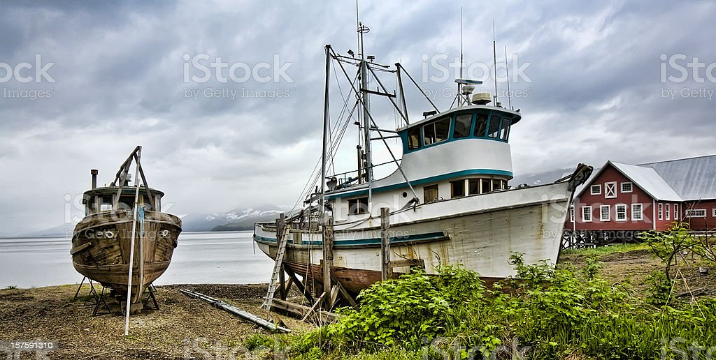 Alaskan Fishing Boats on Beach Colorful With Heavy Sky royalty-free stock photo