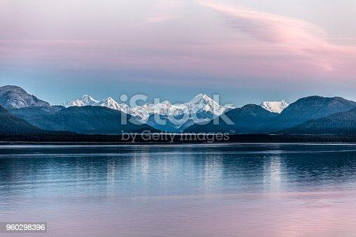 Cruising through Alaska's Glacier Bay National Park at dawn, summer.