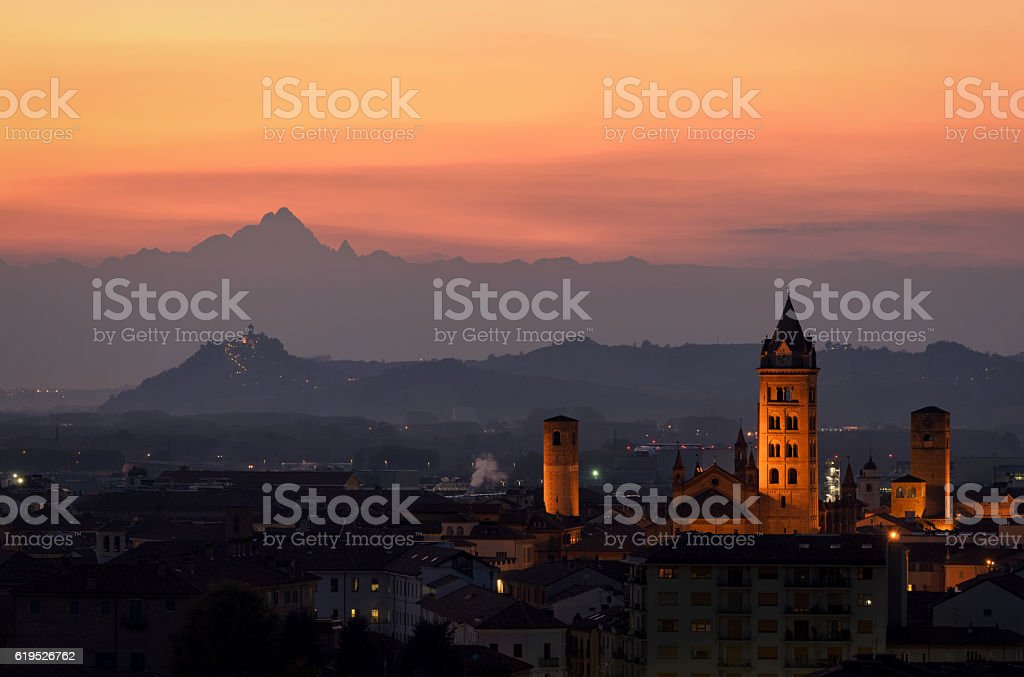 Alba at sunset and Monviso in the background stock photo