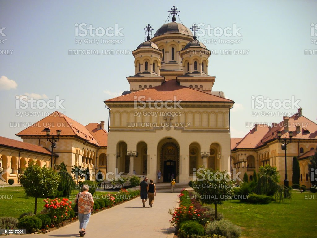 Alba Iulia, Romania - July 24 2013 : tourists visiting the Cathedral in Alba Iulia fortress stock photo