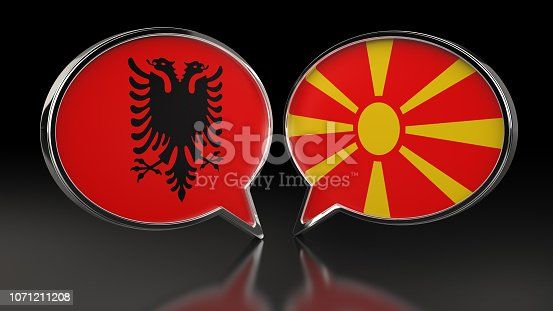 istock Albania and Macedonia flags with Speech Bubbles. 3D illustration 1071211208