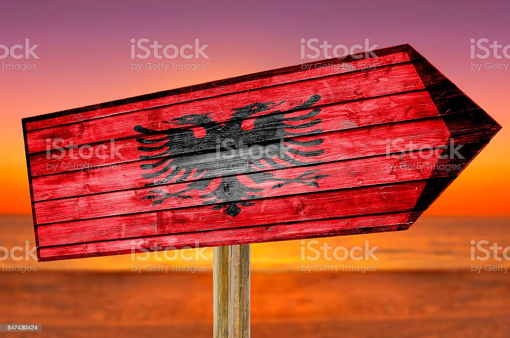 Albania Flag wooden sign with beach background stock photo