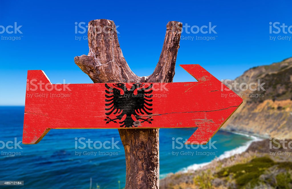 Albania Flag wooden sign with coast background stock photo