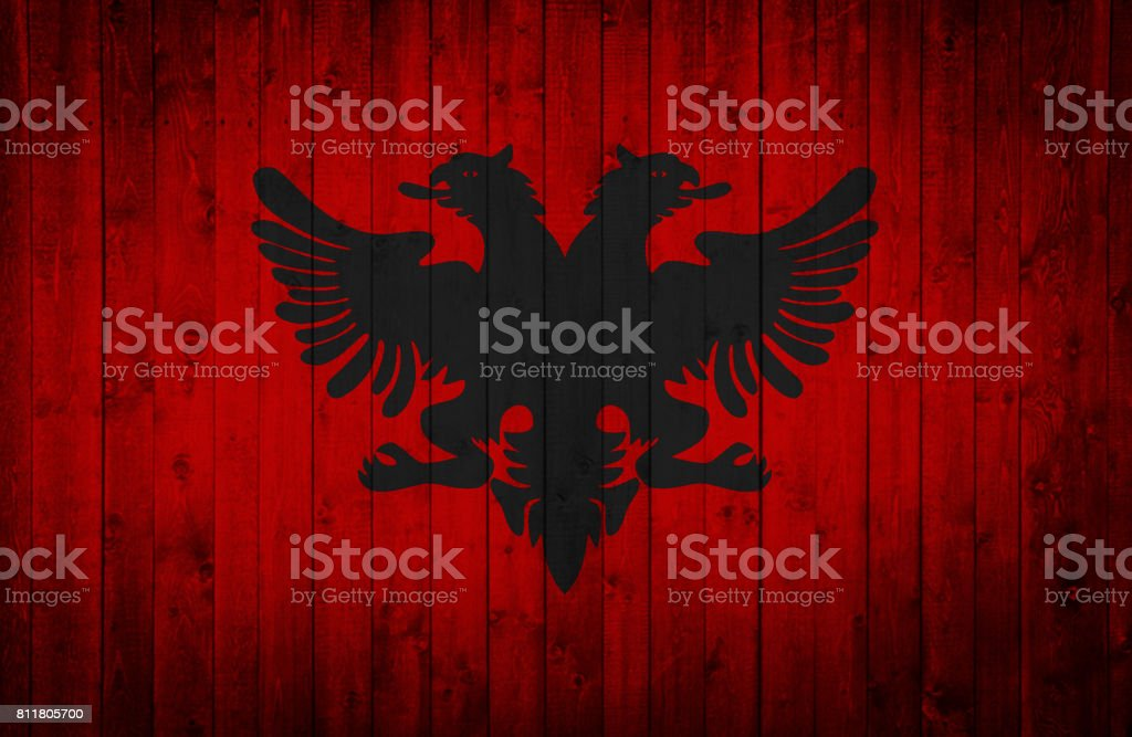 Albanian flag is painted on a wooden surface stock photo