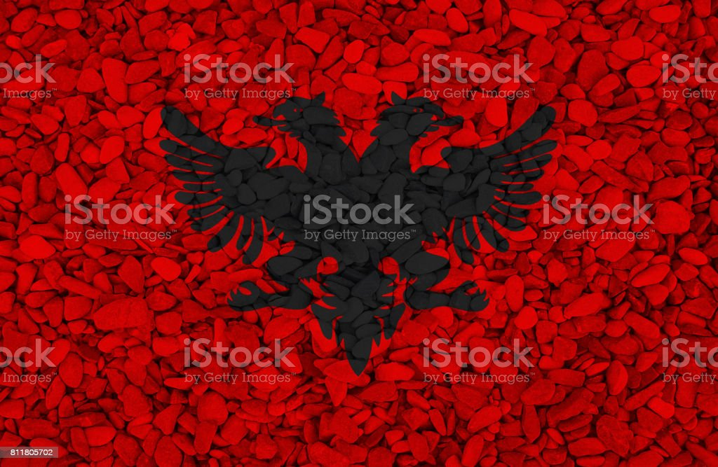 Albanian flag is painted on stones in nature stock photo