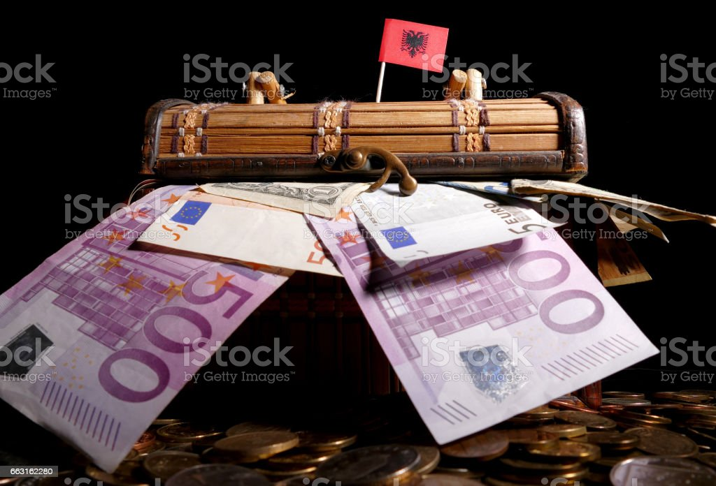 Albanian flag on top of crate full of money stock photo