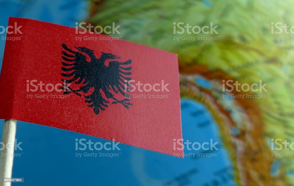 Albanian flag with a globe map as a background stock photo