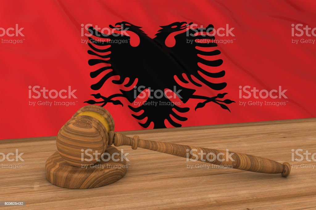 Albanian Law Concept - Flag of Albania Behind Judge's Gavel 3D Illustration stock photo