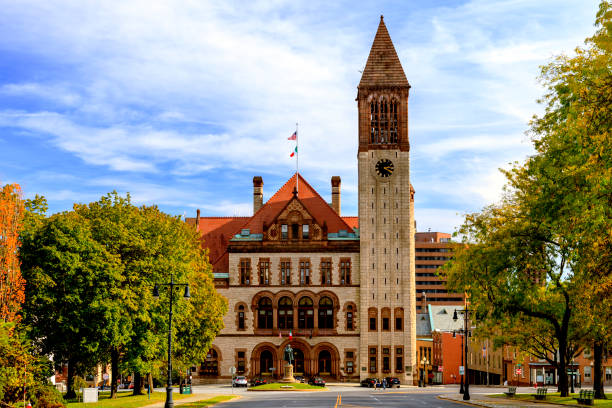 Albany City Hall & Clock Tower The Albany City Hall was built in 1881, designed using the Romanesque style and includes an imposing Clock Tower at one corner.  It was added to the National Register of Historic Places in 1972. albany new york state stock pictures, royalty-free photos & images