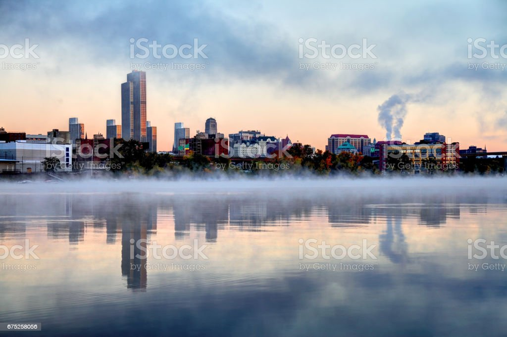 Albany New York skyline reflection along a misty Hudson River stock photo