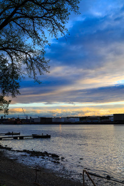 Albany NY docks across the Hudson River from Rensselaer. Springtime sunset, blue hour. stock photo