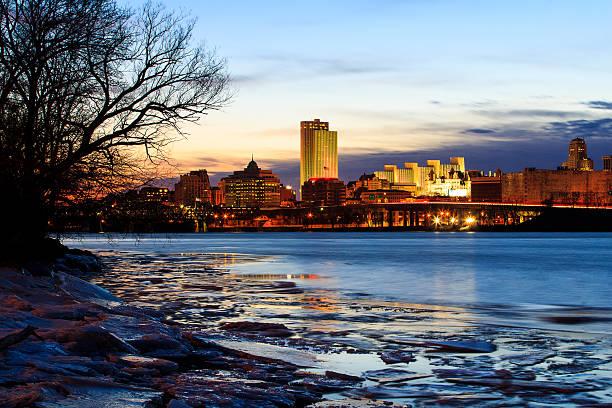 Albany NY skyline at night reflections off the Hudson River stock photo