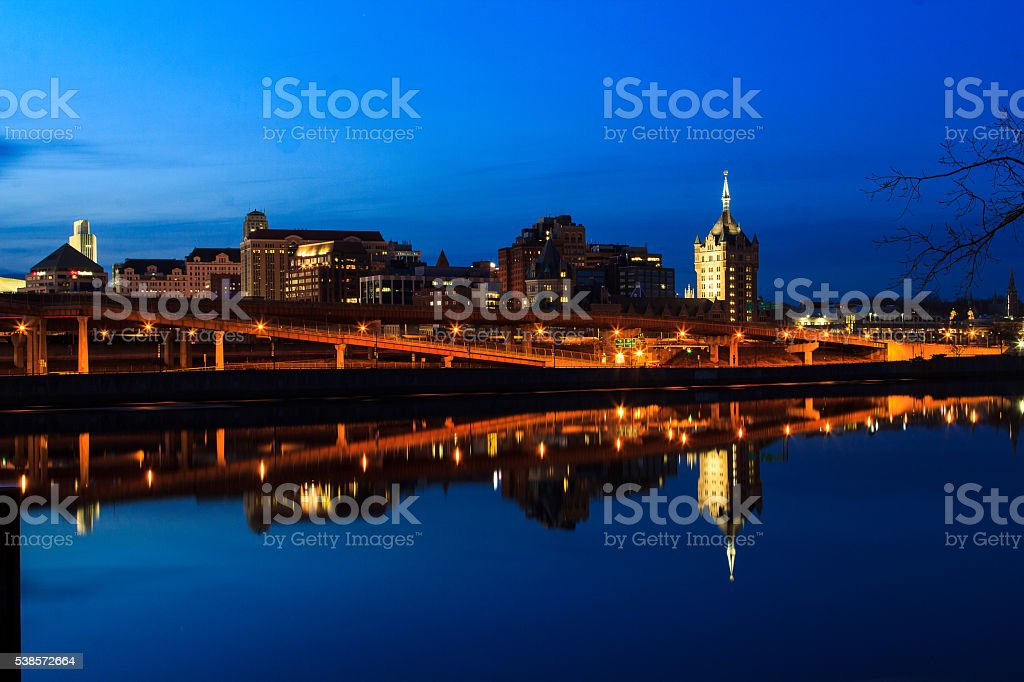 Albany NY skyline at night reflections off the Hudson River stock photo