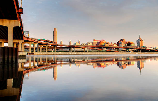 Albany reflecting on the Hudson River Soft morning light on the downtown albany skyline reflecting on the Hudson river. Albany  is the capital city of the US state of New York and is known for its culture, history, architecture, and institutions of higher education albany new york state stock pictures, royalty-free photos & images
