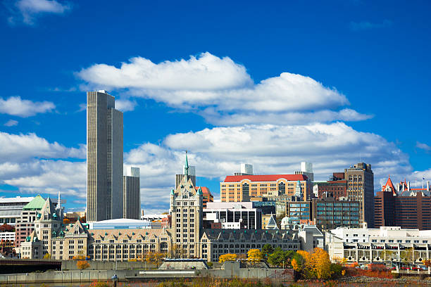 Albany skyline Albany skyline with Corning Tower in the left and the SUNY System Administration Building in the bottom center, with puffy clouds and a blue sky.  Picture taken in Autumn. albany county new york state stock pictures, royalty-free photos & images