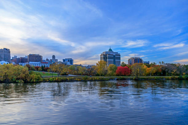 Albany Viewed from the Hudson River Albany NY Skyline with beautiful Fall Colors in Jennings Landing as viewed from the Hudson River at Dusk albany county new york state stock pictures, royalty-free photos & images