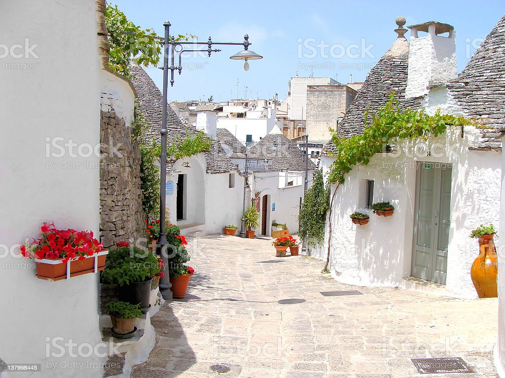 Alberobello Trulli houses with flowers stock photo