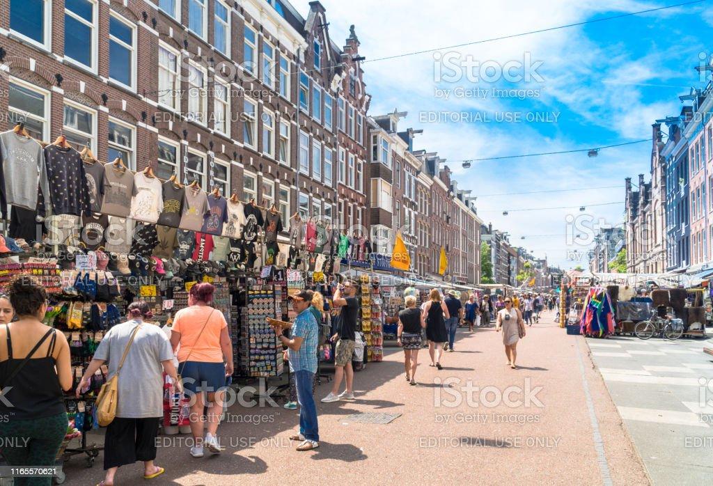 Albert Cuyp Market, Amsterdam, Netherlands Amsterdam, North Holland / Netherlands - June 24th, 2019: People at Albert Cuyp Market shops Amsterdam Stock Photo
