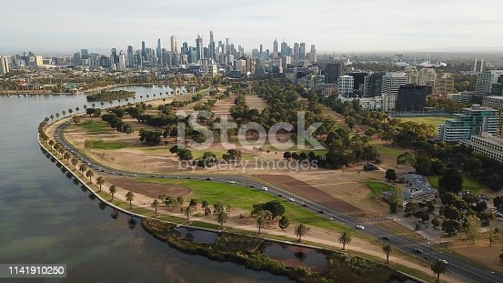 Albert Park Lake in autumn, with Melbourne city in the background.