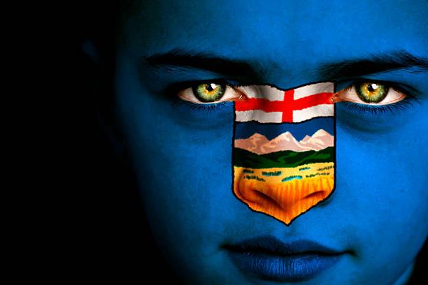 Alberta Canadian Flag Boy stock photo