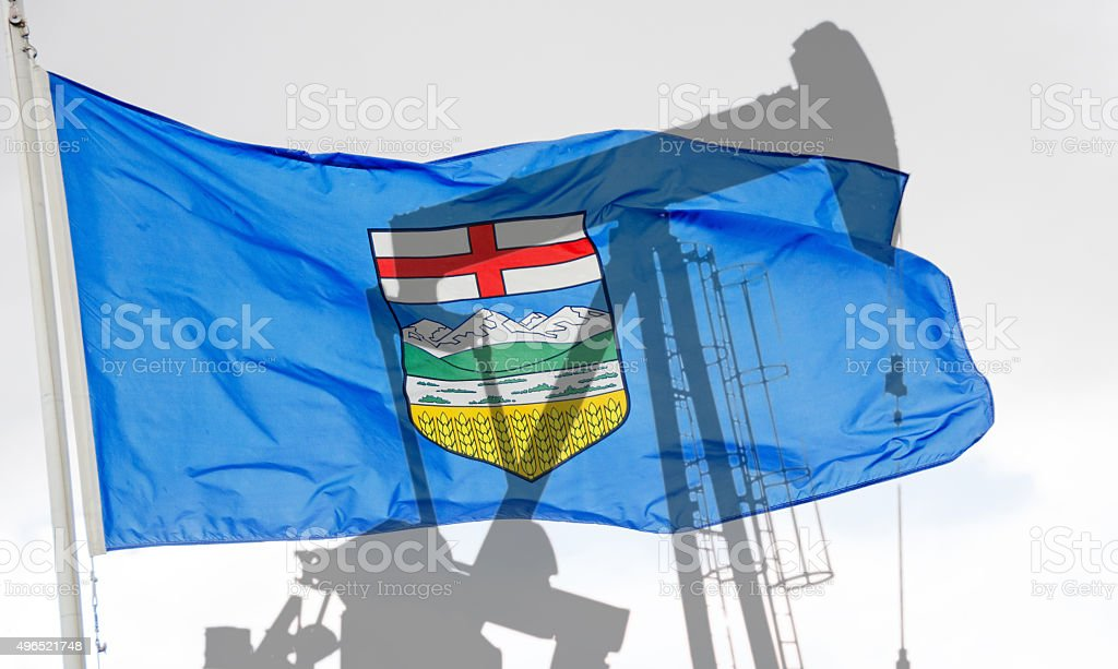 Alberta Flag and shadow of a oil well pump- concepual stock photo