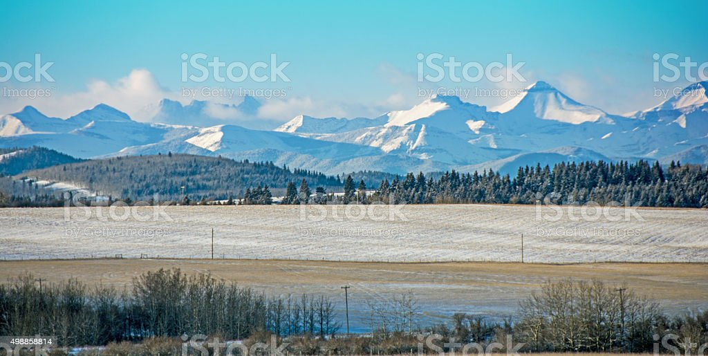 Alberta prairie scene with Rocky Mountains in background stock photo