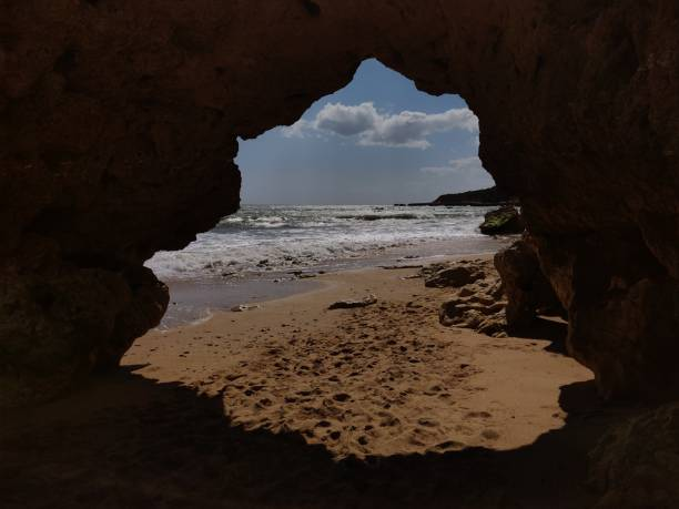 Albufeira natural cliff passage. stock photo