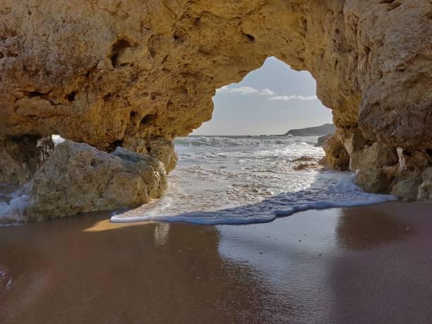 Albufeira natural rock arch. stock photo