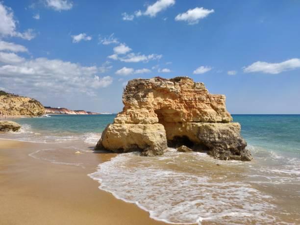 Albufeira sunny natural seashore. stock photo