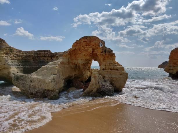 Albufeira water's edge natural coastline. stock photo