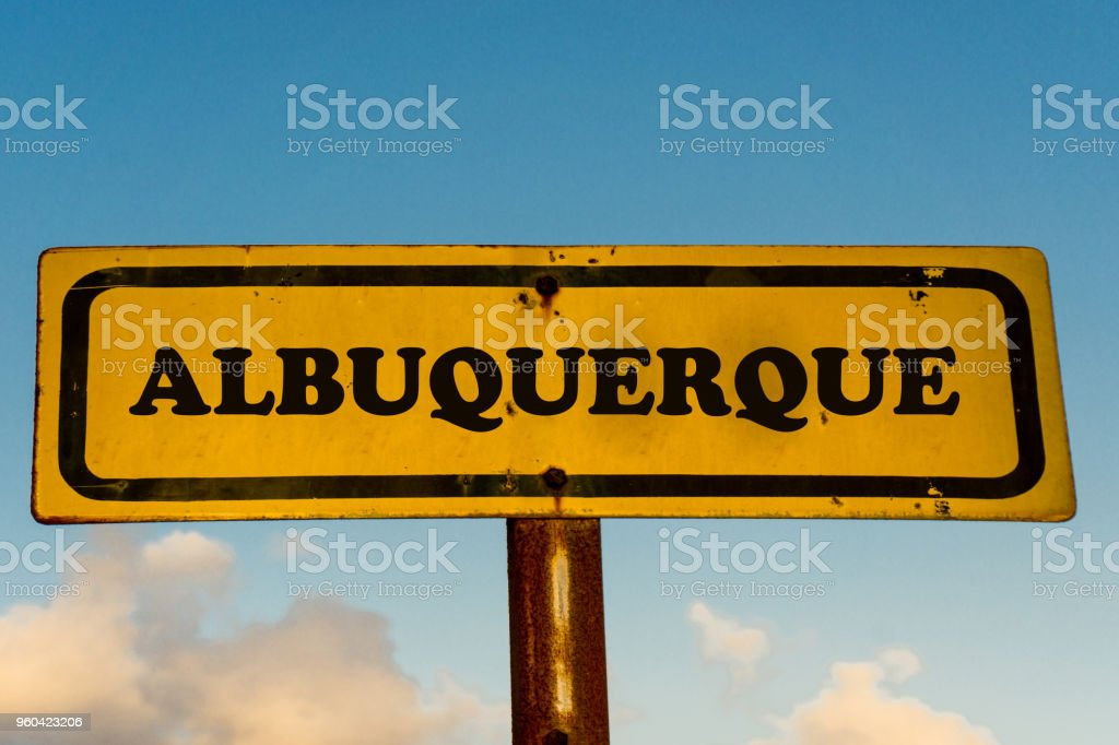 Albuquerque city street old antique yellow sign with blue sky at background, USA signal city series. stock photo