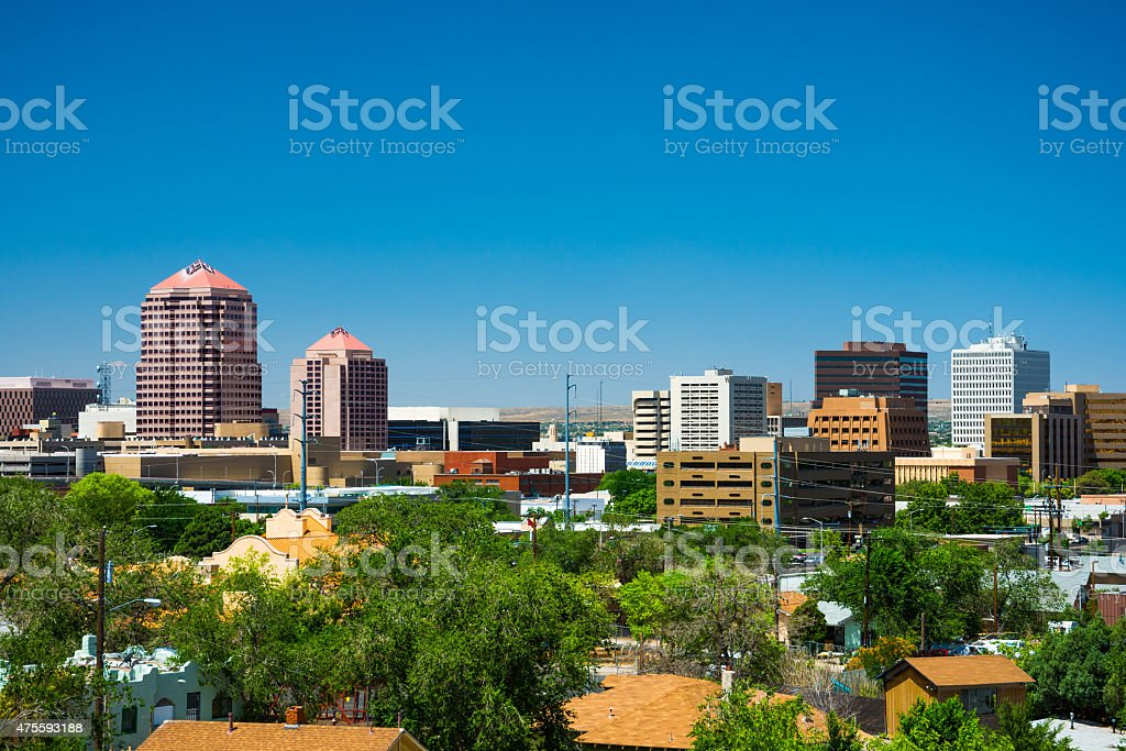 Albuquerque downtown skyline, elevated view, with trees and residential neighborhood stock photo