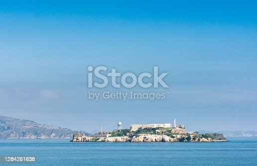 Alcatraz Island, famously the location for the iconic prison, as well as a lighthouse and other federal structures, located off the San Francisco coast in California.