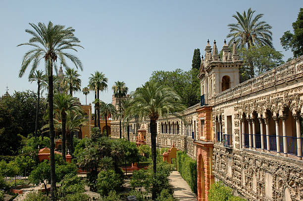 Alcazar Gardens Seville Spain Alcazar Gardens Seville Spain with palm-trees in daylight alcazar palace stock pictures, royalty-free photos & images