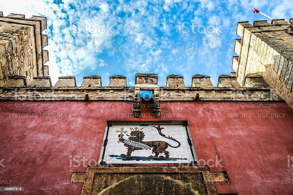 Alcazar of Seville - Colorful sky contrasted with Moorish architecture stock photo