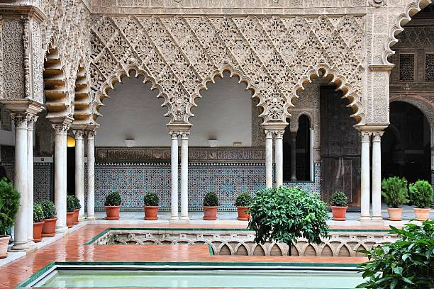 Alcazar of Seville Seville, Spain - Alcazar Palace, famous UNESCO World Heritage Site. Moorish architecture. alcazar palace stock pictures, royalty-free photos & images